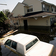 NEW ORLEANS, LA - September 4, 2005:  A flooded car sits in front of a flooded home in New Orleans on Sept 4, 2005 after Hurricane Katrina took its' toll. (Photo by Todd Bigelow/Aurora)