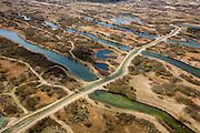 Nederland, Noord-Holland, Gemeente Bloemendaal, 16-04-2008; Amsterdamse Waterleiding Duinen (Amsterdamse Waterleidingduinen), waterwingebied van Waternet; in de duinen wordt - voorgezuiverd rivierwater - in de duinen geinfiltreerd; het zand zuivert het water tot voor consumptie geschikt drinkwater; een van de afwateringskanalen diagonaal in beeld; infiltratie, infiltratiegebied, Vogelenzang, leidingwater, kraanwater, waterleiding, verdroging, waterzuivering, zand, duin ..luchtfoto (toeslag); aerial photo (additional fee required); .foto Siebe Swart / photo Siebe Swart