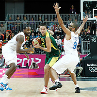 02 August 2012: Lithuania Mantas Kalnietis looks to pass past Ronny Turiaf and Tony Parker during 82-74 Team France victory over Team Lithuania, during the men's basketball preliminary, at the Basketball Arena, in London, Great Britain.