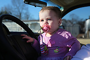 Baby Priscilla Presley in her dad's pick up.<br /> <br /> Murphy Village, North Augusta, South Carolina is a community of around 2000 Irish Travellers who settled there in the late 60s. They bought some land, following the advice of Catholic priest Father Murphy who also had a catholic church, St Edward, built in Murphy village.