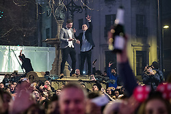 © Licensed to London News Pictures . 01/01/2017 . Manchester , UK . Thousands gather as Manchester celebrates the start of 2017 , with a fireworks display in front of the Town Hall in Albert Square . Photo credit : Joel Goodman/LNP