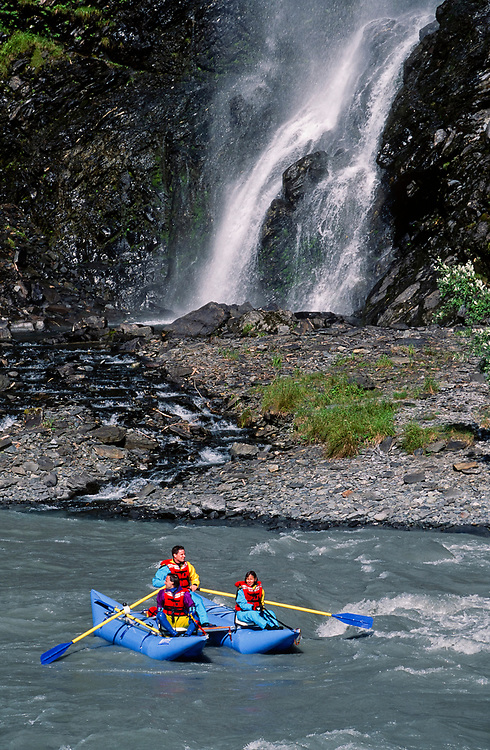 Alaska. Keystone Canyon near Valdez, Alaska. Whitewater rafters pass by Bridal Veil Falls.