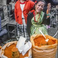 A woman sells turmeric spice at an outdoor market in Kathmandu, Nepal, 1986.