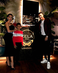 """Cristiano Ronaldo releases a photo on Instagram with the following caption: """"About last night! Amazing dinner at @zelalondon \ud83d\udc4c\ud83c\udffd\ud83d\udd1d"""". Photo Credit: Instagram *** No USA Distribution *** For Editorial Use Only *** Not to be Published in Books or Photo Books ***  Please note: Fees charged by the agency are for the agency's services only, and do not, nor are they intended to, convey to the user any ownership of Copyright or License in the material. The agency does not claim any ownership including but not limited to Copyright or License in the attached material. By publishing this material you expressly agree to indemnify and to hold the agency and its directors, shareholders and employees harmless from any loss, claims, damages, demands, expenses (including legal fees), or any causes of action or allegation against the agency arising out of or connected in any way with publication of the material."""