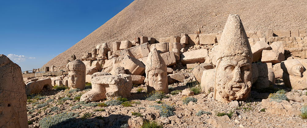 Statue head of from left,  Commagene, Apollo, Herekles & Eagle in front of the 62 BC Royal Tomb of King Antiochus I Theos of Commagene, west Terrace, Mount Nemrut or Nemrud Dagi summit, near Adıyaman, Turkey .<br /> <br /> If you prefer to buy from our ALAMY PHOTO LIBRARY  Collection visit : https://www.alamy.com/portfolio/paul-williams-funkystock/nemrutdagiancientstatues-turkey.html<br /> <br /> Visit our CLASSICAL WORLD HISTORIC SITES PHOTO COLLECTIONS for more photos to download or buy as wall art prints https://funkystock.photoshelter.com/gallery-collection/Classical-Era-Historic-Sites-Archaeological-Sites-Pictures-Images/C0000g4bSGiDL9rw