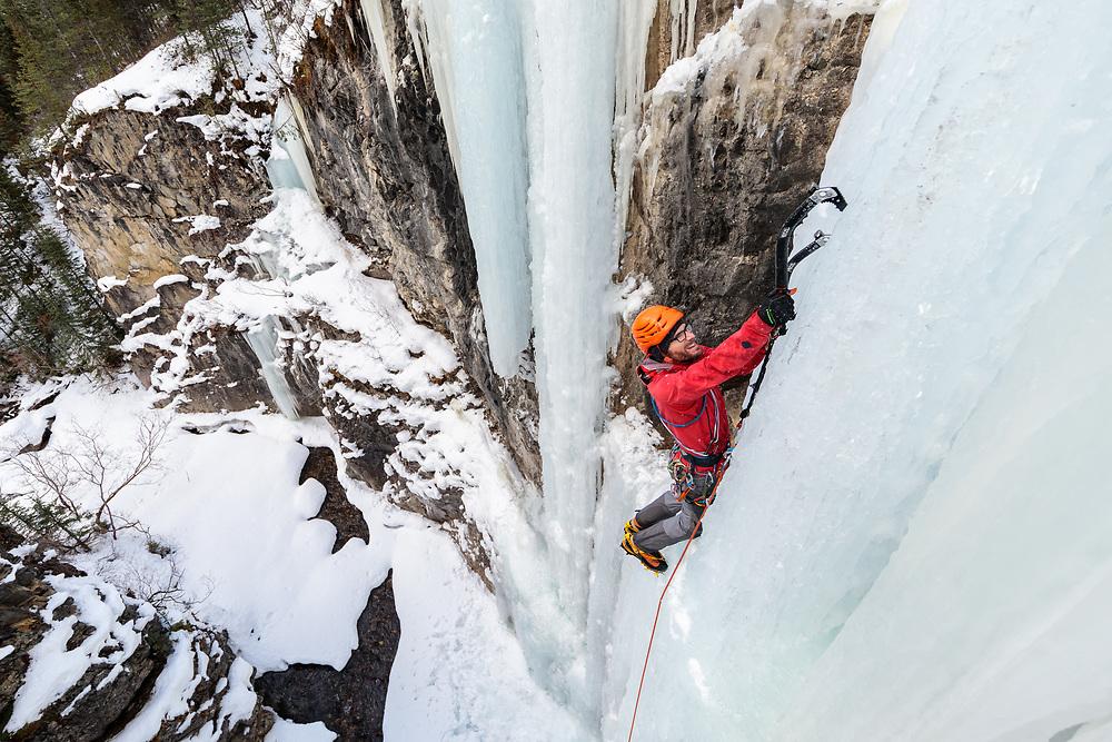 Jas Fauteux ice climbing Tasting Fear, a 30m WI5 in Kananaskis, Alberta, Canada