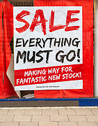 Sale Everything Must Go stock clearance shop window sales poster, UK
