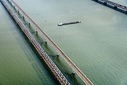Nederland, Zuid-Holland, Hollandsch Diep, 01-04-2016; binnenvaartschip passeert Moerdijkbruggen over Hollandsch Diep. <br /> Railwaybridges across Hollandsch Diep, motorway and two railway bridges. <br /> luchtfoto (toeslag op standard tarieven);<br /> aerial photo (additional fee required);<br /> copyright foto/photo Siebe Swart
