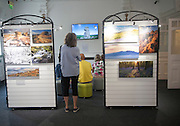 People watching a multimedia image display in the Dartmoor national park visitor centre, Princetown, Devon, England