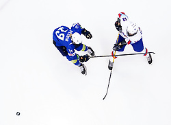 Iceland's Saga Blondal (right) and Slovenia's Gaja Pezdir battle for the puck during the Beijing 2022 Olympics Women's Pre-Qualification Round Two Group F match at the Motorpoint Arena, Nottingham.