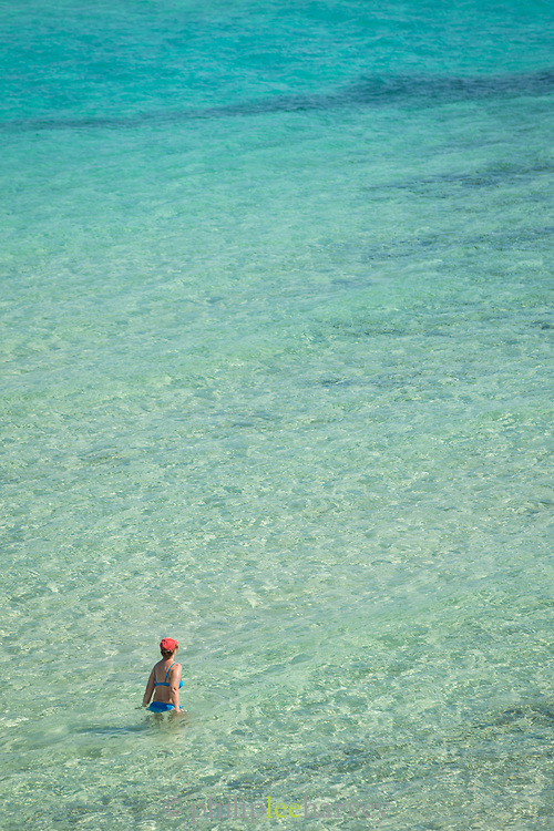 High angle view of tourist enjoying transparent waters of Gialiskari beach, Ikaria, Greece