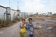 Sara and her friend Maryam Ziad, both age 10, stand outside the IDP camp they currently call home. The camp was set up for Iraqi Christians displaced from Qaraqosh and other towns in the Ninevah plains by the 2014 ISIS advance. The camp is in Ankawa, a suburb of Erbil in northern Iraq. (May 18, 2017)