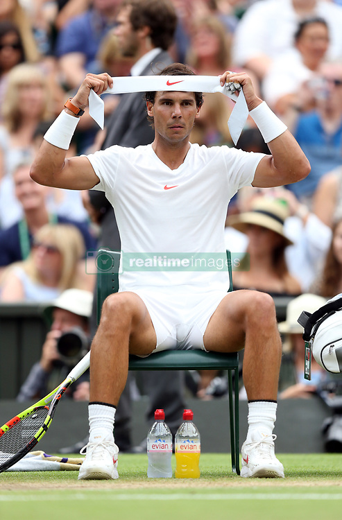 Rafael Nadal during a change of ends in the fourth set of the men's semi final on day twelve of the Wimbledon Championships at the All England Lawn Tennis and Croquet Club, Wimbledon.