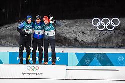 February 12, 2018 - Pyeongchang, SOUTH KOREA - 180212  Sebastian Samuelsson of Sweden, Silver, Martin Fourcae of France, Gold,  and Benedikt Doll of Germany, Bronze, celebrates on the podium after in the Men's Biathlon 12,5km Pursuit during day three of the 2018 Winter Olympics on February 12, 2018 in Pyeongchang..Photo: Jon Olav Nesvold / BILDBYRN / kod JE / 160157 (Credit Image: © Jon Olav Nesvold/Bildbyran via ZUMA Press)