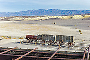 Ruins of the Harmony Borax Works with Twenty Mule Team ore wagons and water tanker Death Valley National Park, California, USA