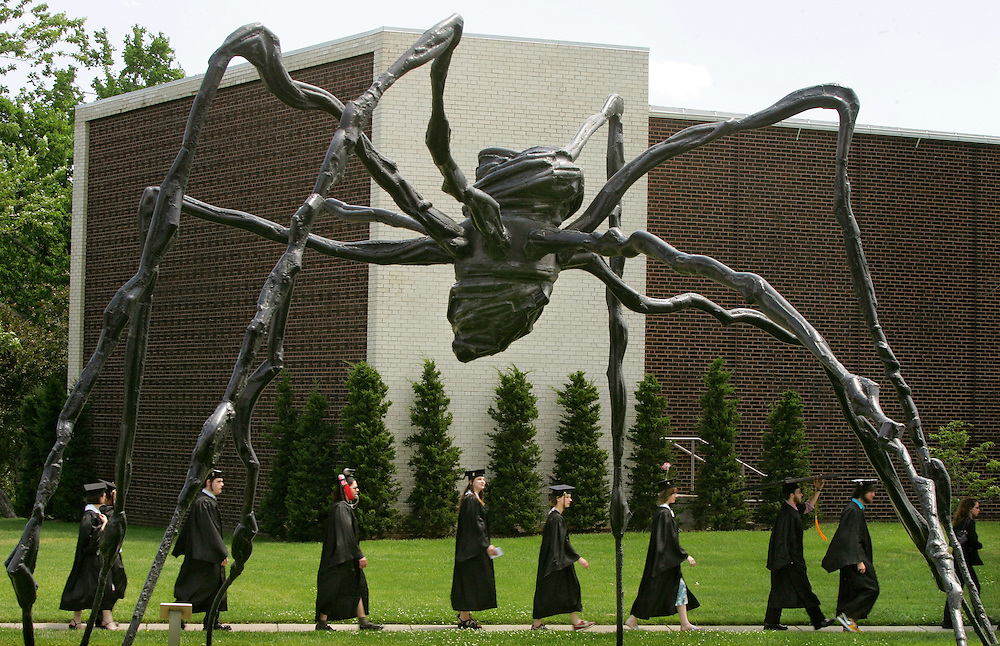 """Students from the Kansas City Art Institute walk in procession to their graduation Saturday afternoon past the Louise Bourgeois sculpture """"Spider, 1997"""" at the Kemper Museum of Contemporary Art in Kansas City, Mo. The students were walking from the Art Institute campus to the Community Christian Church at 4601 Main Street, where the ceremony was held."""