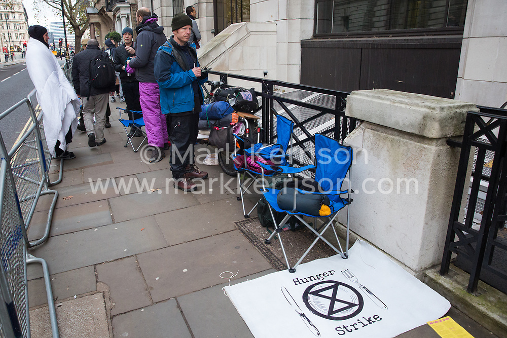 London, UK. 19 November, 2019. Hunger striking climate activists from Extinction Rebellion stand outside the Liberal Democrat headquarters on the second day of an 'Election Rebellion' hunger strike with three demands for election candidates: to tell the truth by declaring a Climate and Ecological Emergency, to promote policies to halt biodiversity loss and reduce greenhouse gas emissions to net zero by 2025 and to help the Government create and be led by a Citizen's Assembly on climate and ecological justice.