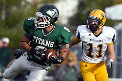 12 November 2011:  Joe Musso pulls in a pass while defended by Cole Urban during an NCAA division 3 football game between the Augustana Vikings and the Illinois Wesleyan Titans in Tucci Stadium on Wilder Field, Bloomington IL