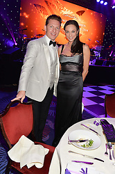 NICK CANDY and LILY BECKER at the Caudwell Children's annual Butterfly Ball held at The Grosvenor House Hotel, Park Lane, London on 15th May 2014.