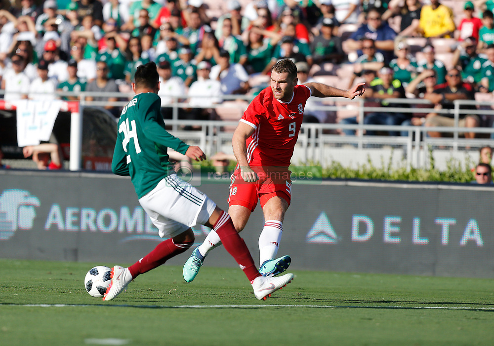 May 28, 2018 - Pasadena, CA, U.S. - PASADENA, CA - MAY 28: Same Vokes of Wales makes a pass by Hugo Ayala of Mexico during the game on May 28, 2018, at the Rose Bowl in Pasadena, CA.  (Photo by Adam  Davis/Icon Sportswire) (Credit Image: © Adam Davis/Icon SMI via ZUMA Press)