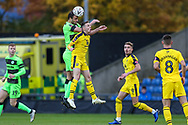 Forest Green Rovers Farrend Rawson(6) out jumps Oxford United's Gavin Whyte(16) during the The FA Cup 1st round match between Oxford United and Forest Green Rovers at the Kassam Stadium, Oxford, England on 10 November 2018.