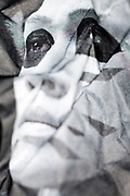 crumpled newspaper portrait of Kenji Darvish from the Golden Bombers a Japanese visual kei air rock band