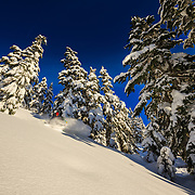 Tyler Hatcher grabs late afternoon powder turns in the Cascades of Washington.