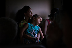 26 September 2015, Trinidad, Cuba: A young mother and her son return to their home village after a day in Trinidad, Cuba in 2015, by way of the old but functional commuter train that runs through the countryside.
