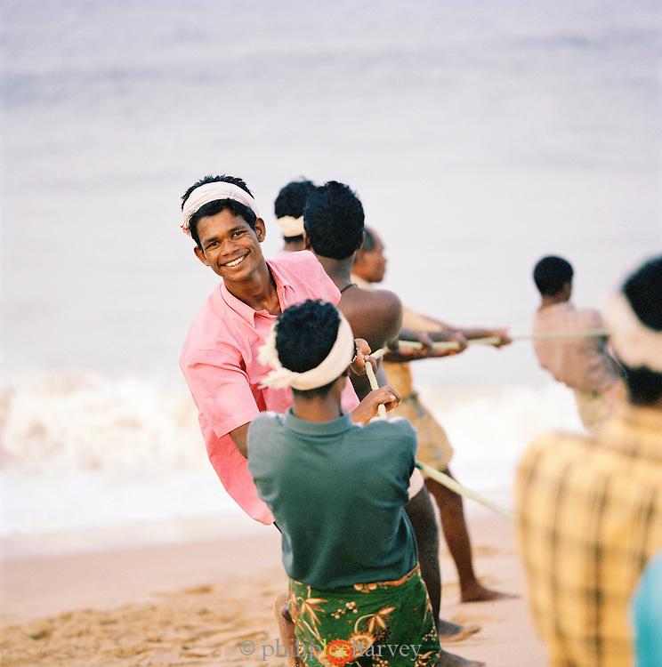 Fishermen bring in their catch before the monsoon rains begin onOdayam Beach, Kerala, India