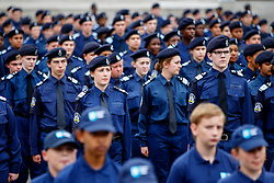 © Licensed to London News Pictures. 03/08/2015. London, UK. Volunteer police cadets attend a parade for the capital's young police volunteers in Trafalgar Square, London on Monday, August 3, 2015. Photo credit: Tolga Akmen/LNP