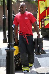 Exhausted fire crews change shift after working 12 hours at the Grenfell Tower blaze<br />