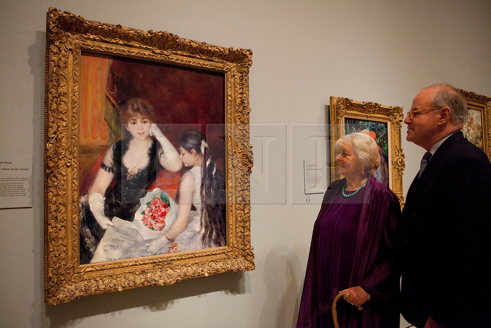 © under license to London News Pictures. 25/06/12. London, UK. Granddaughter of Francine Clark, Mrs Javotte Ray and Director of the Clark Institute, Michael Conforti stand by the famous paining, A Box at the Theatre,1880, by Pierre-Auguste Renoir. The exhibition takes place at the Royal Academy of Arts. From Paris: A Taste of Impressionism - paintings from the Clark exhibition. The exhibition showcases seventy major works, many of which have never been on public display in the U.K before...ALEX CHRISTOFIDES/LNP