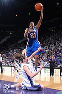 Kansas guard Shaquina Mosley (21) drives over Kansas State's Ashley Sweat for the score, during the first half at Bramlage Coliseum in Manhattan, Kansas, January 24, 2007.  K-State beat Kansas 59-55.