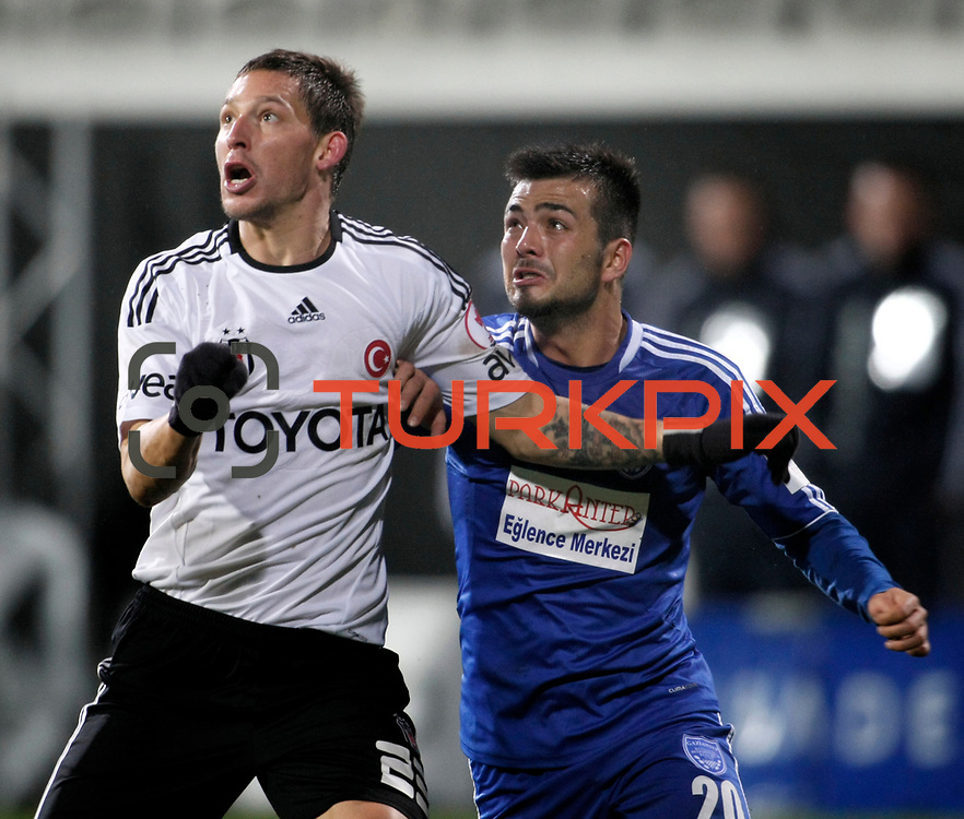 Besiktas's Filip Holosko (L) and Gaziantepspor BSB's Ahmet Devret (R) during their Turkey Cup matchday 3 soccer match Besiktas between Gaziantepspor BSB at the Inonu stadium in Istanbul Turkey on Wednesday 11 January 2012. Photo by TURKPIX