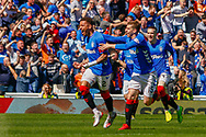James Tavernier (C) of Rangers FC scores from an early free kick to give his side the lead during the Ladbrokes Scottish Premiership match between Rangers and Celtic at Ibrox, Glasgow, Scotland on 12 May 2019.