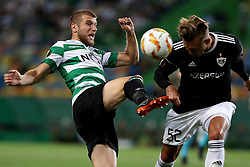 September 20, 2018 - Lisbon, Portugal - Sporting's defender Stefan Ristovsk from Macedonia (L) fights for the ball with Qarabag's defender Jakub Rzezniczak during the UEFA Europa League Group E football match Sporting CP vs Qarabag at Alvalade stadium in Lisbon, on September 20, 2018. (Credit Image: © Pedro Fiuza/NurPhoto/ZUMA Press)