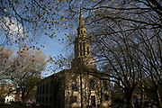 Autumn light through trees on St. Pauls Square and church in Birmingham, United Kingdom.