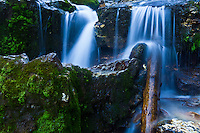 One of many smaller waterfalls cascading down the mountain near Donut Falls in Big Cottonwood Canyon, Utah.