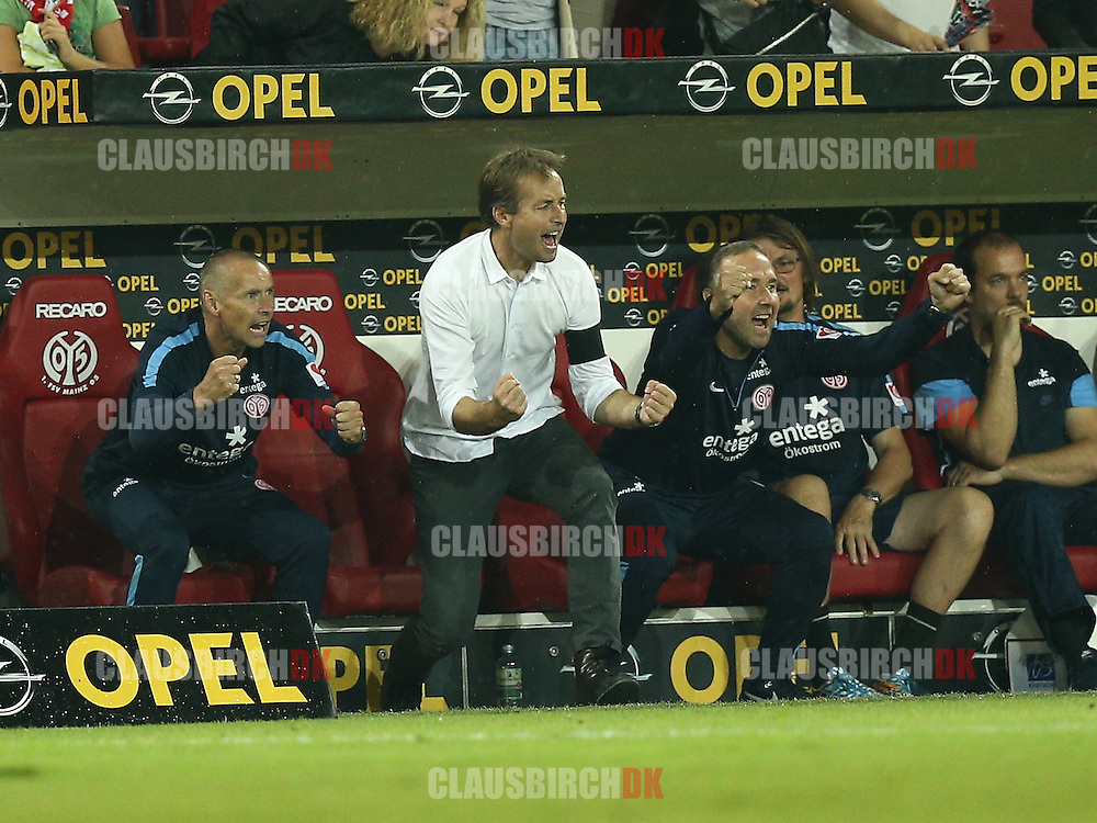FOOTBALL: Assistant Coach Flemming Pedersen, Head Coach Kasper Hjulmand and Assistant Coach Keld Bordinggard celebrates the win after the Bundesliga match between 1. FSV Mainz 05 and Borussia Dortmund at Coface Arena on September 20, 2014 in Mainz, Germany. Photo: Claus Birch.