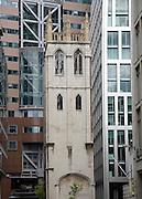 St Alban tower dwarfed by modern buildings, Wood Street, London, England