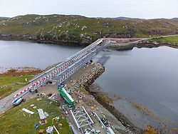 Aerial view from drone of new bridge under construction linking islands of  Great Bernera and Lewis in the Western Isles. Steel truss single span bridge designed and built by Mabey was selected. Isle of Lewis, Outer Hebrides, Scotland, UK