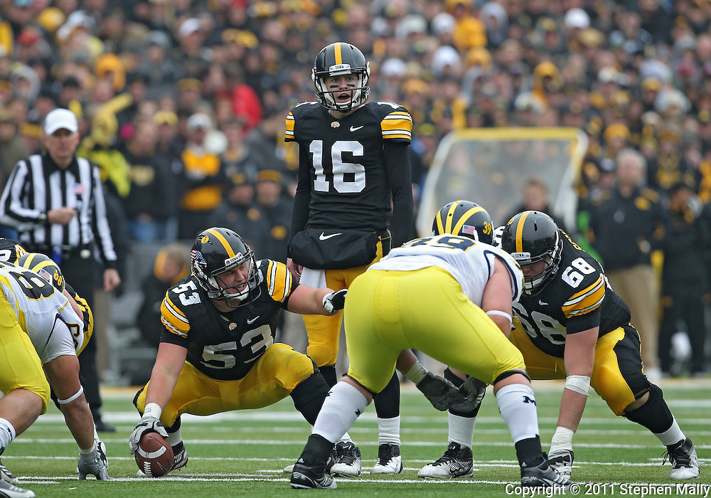 November 05, 2011: Iowa Hawkeyes offensive linesman James Ferentz (53) and Iowa Hawkeyes quarterback James Vandenberg (16) call out signals at the line during the second half of the NCAA football game between the Michigan Wolverines and the Iowa Hawkeyes at Kinnick Stadium in Iowa City, Iowa on Saturday, November 5, 2011. Iowa defeated Michigan 24-16.