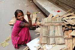 A young girl collects the rubbish in Chandni Chowk in Delhi India.  The Commonwealth Games are being held in Delhi India between the 3rd and 14th October 2010..Photoby:  Ron Gaunt/SPORTZPICS