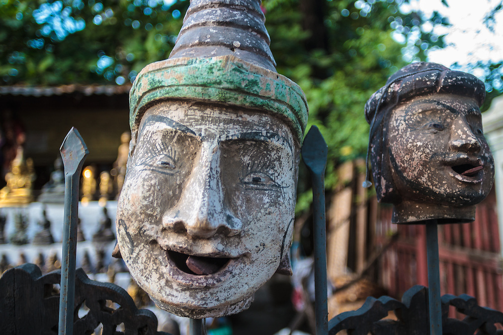 Puppet heads for sale in street market in Mandalay.