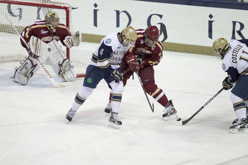 Boston College defenseman Tommy Cross (#4) and Notre Dame center Riley Sheahan (#4) battle in action during NCAA hockey game between Notre Dame and Boston College.  The Notre Dame Fighting Irish defeated the Boston College Eagles 3-2 in game at the Compton Family Ice Arena in South Bend, Indiana.