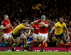 Jonathan Davies of Wales evades the tackle of Izack Rodda of Australia<br /> <br /> Photographer Simon King/Replay Images<br /> <br /> Under Armour Series - Wales v Australia - Saturday 10th November 2018 - Principality Stadium - Cardiff<br /> <br /> World Copyright © Replay Images . All rights reserved. info@replayimages.co.uk - http://replayimages.co.uk