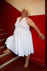 Visually impaired man dressed as Marilyn Monroe for theatrical performance, backstage.