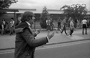 H-Block Protest To British Embassy.  (N86)..1981..18.07.1981..07.18.1981..18th July 1981..A protest march to demonstrate against the H-Blocks in Northern Ireland was held today in Dublin. After the death of several hunger strikers in the H-Blocks feelings were running very high. The protest march was to proceed to the British Embassy in Ballsbridge...Image shows a marcher asking 'What is happening'