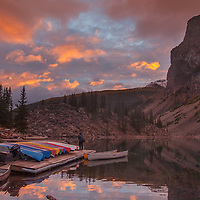 A sunrise lights up the Canadian Rockies and the canoe rental dock at Moraine Lake Lodge.