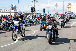 © Licensed to London News Pictures. 09/09/2016. Brighton, UK. Members of dozens of biker clubs take part in the yearly ACE Cafe London to Brighton rally. Thousands of participants ride from the London ACE Cafe to Madeira Drive in Brighton to raise funds for charity. Photo credit: Hugo Michiels/LNP